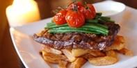£29 -- Trafalgar Square: Steak Meal for 2 inc Bubbly
