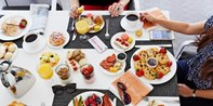 The Beverly Hilton: Poolside Brunch for 2 w/Unlimited Bubbly