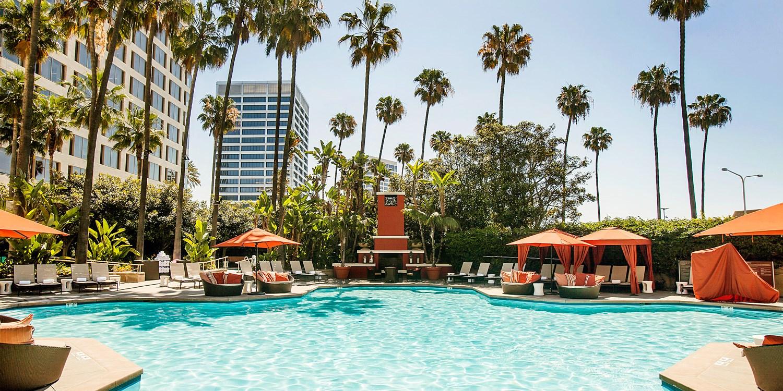 $99 & up -- Island Hotel: Luxe Mani/Pedi or Massage w/Pool