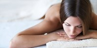 Top-Rated Facial or Massage w/Bubbly in Midtown, Reg. $120
