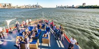 Spend Happy Hour on a Yacht around NYC w/Endless Drinks
