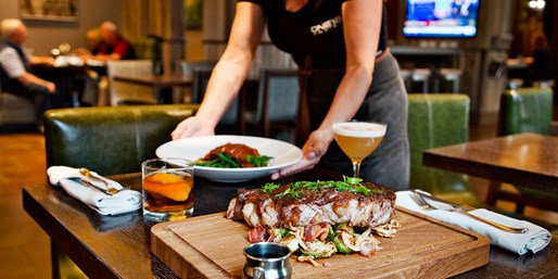 $55 -- Dinner for 2 at 'Distinguished' Whiskey Bar, Reg. $93