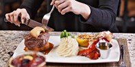 $75 -- Steak & Lobster Dinner for 2 at Stratosphere