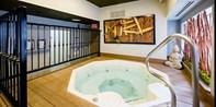 $119 -- Village Spa: RMT Massage & Pedicure w/Bubbly