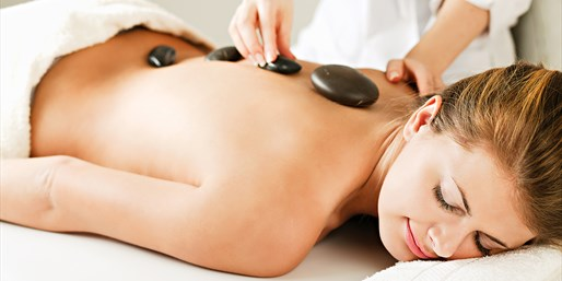 $55 -- Deep Tissue Hot Stone Massage w/Wine, 45% Off