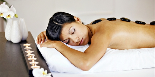 $49 & up -- Hot Stone Massage & Facial Packages, 60% Off