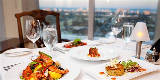$79 -- Private Club: 28th-Floor Dinner for 2 w/Ocean Views