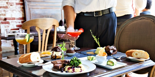 $55 -- Top-Rated French Dining for 2 w/Cocktails, Reg. $104