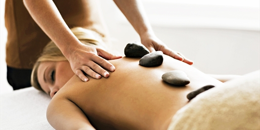 $65 -- Hollywood: Hot Stone Massage w/Aromatherapy, 60% Off