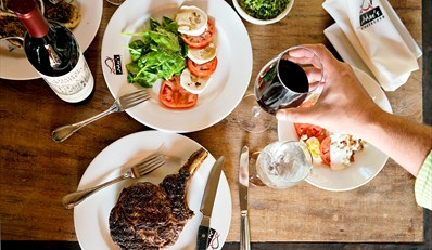 $55 -- Mac's: Steak & Seafood Dinner for 2 w/Wine, Reg. $113