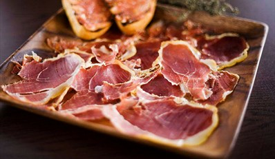 $59 -- Spanish Tapas, Platter, Sangria & More for 2, 53% Off