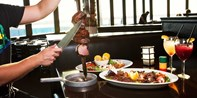 $60 -- Unlimited Brazilian Dinner for 2 or Brunch w/Mimosas