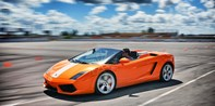 Drive a Lamborghini or Ferrari on a Closed Course, Half Off