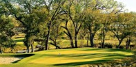 $35 -- Champions Circle Golf: 18 Holes w/Cart, Reg. $75
