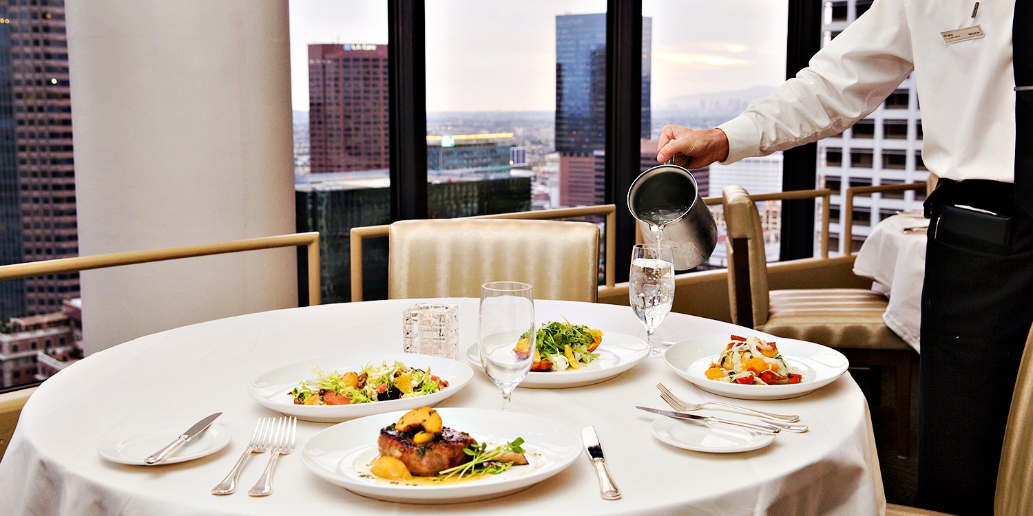 $99 -- 35th-Floor Steak Dinner for 2 w/Wine, 50% Off