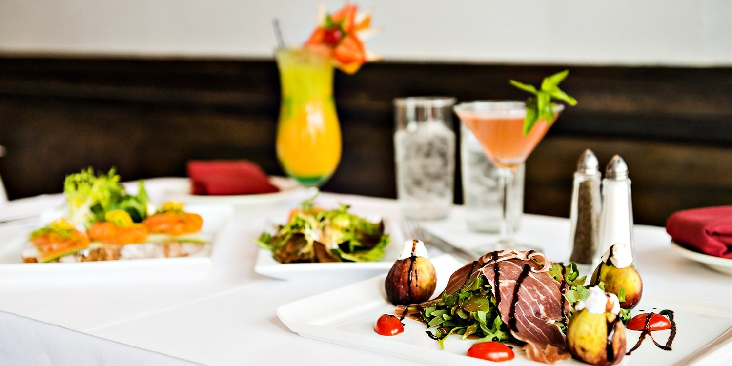 $25 -- Top-Rated UES Cafe: Drinks & Apps for 2, Reg. $50