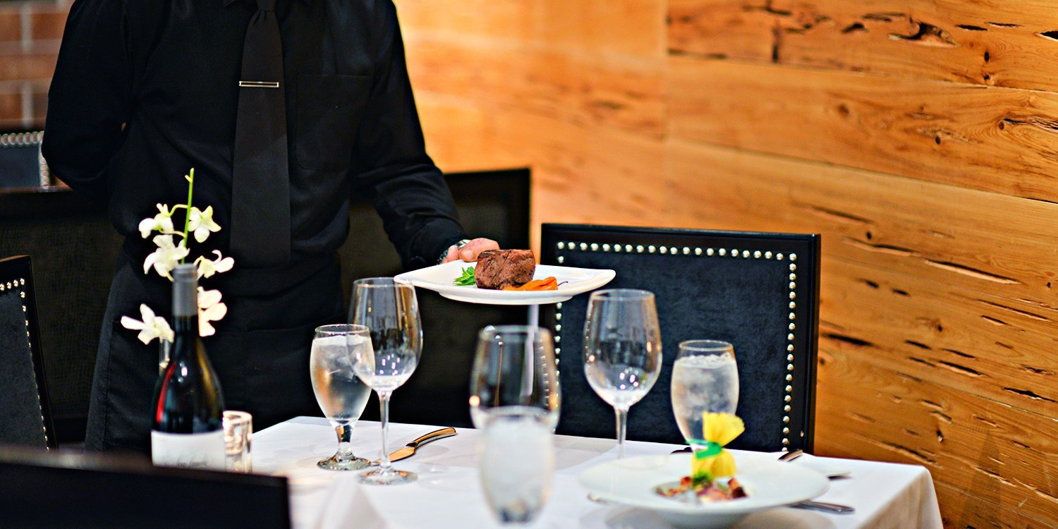 $80 -- Vines: 'First-Rate' Steakhouse Dinner for 2, Save 40%