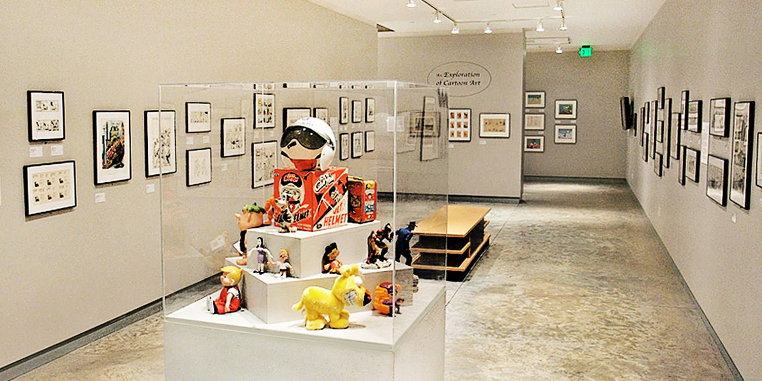 $8 -- Cartoon Art Museum: Day for 2 w/Comic Books