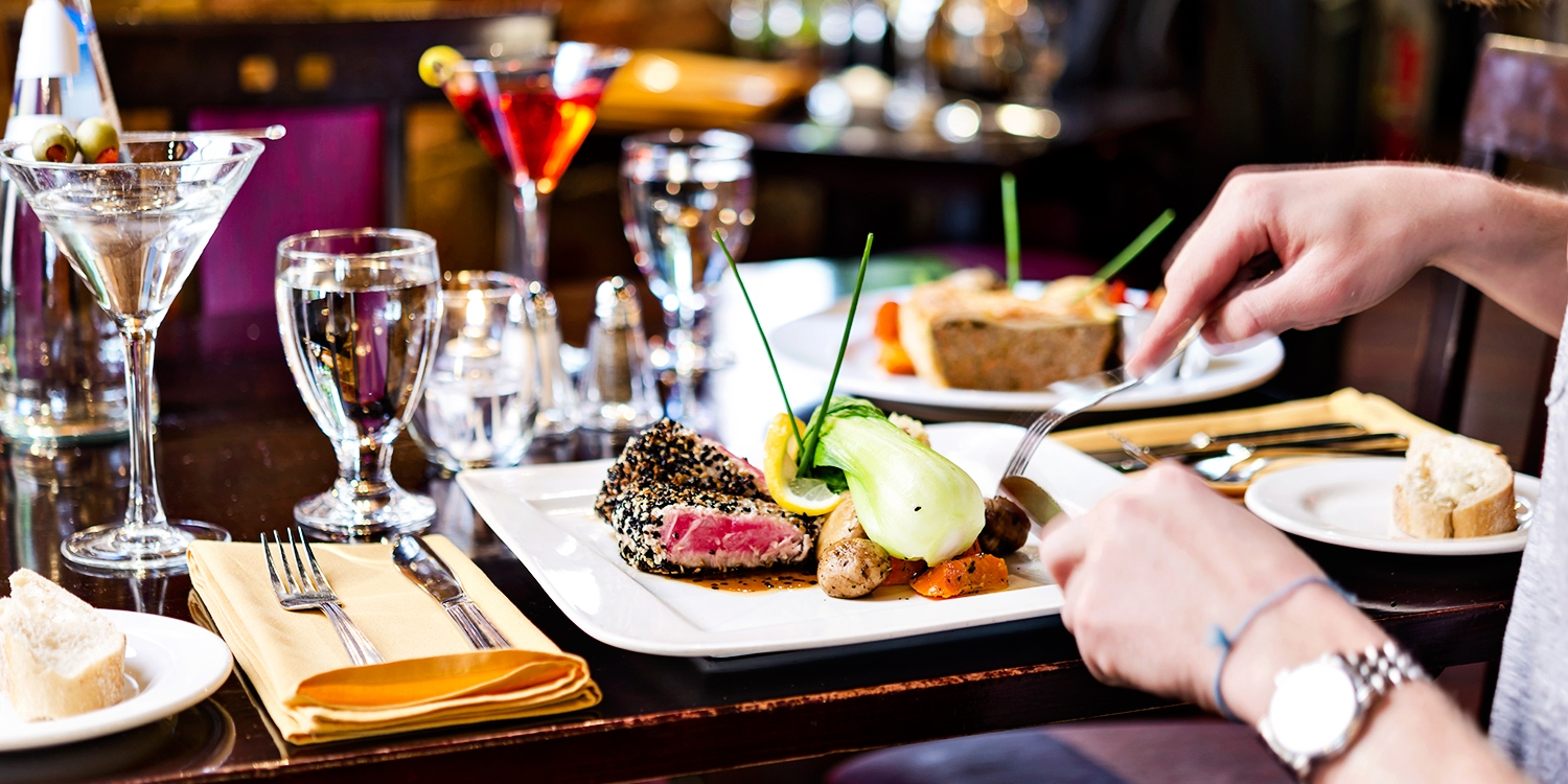 $44 -- Parisian Dining for 2 w/Cocktails on Front, Reg. $89