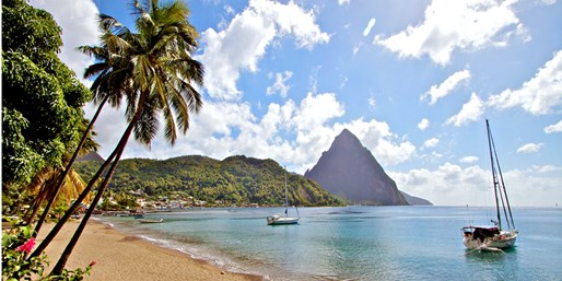 $1005 & up -- St. Lucia 4-Star Villa Beach Getaway incl. Air