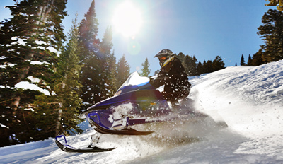 $99 - Snowmobile Thrill Ride for 2 incl. Guide, Reg. $260