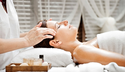$50 -- Allure Magazine Pick: Massage or Facial, Half Off