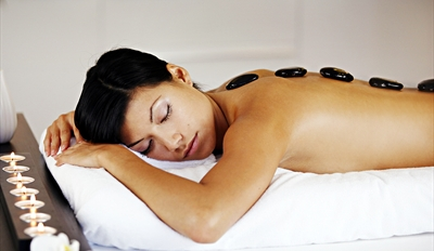 $59 - Downtown Spa: Hot Stone Massage & Facial, Reg. $163
